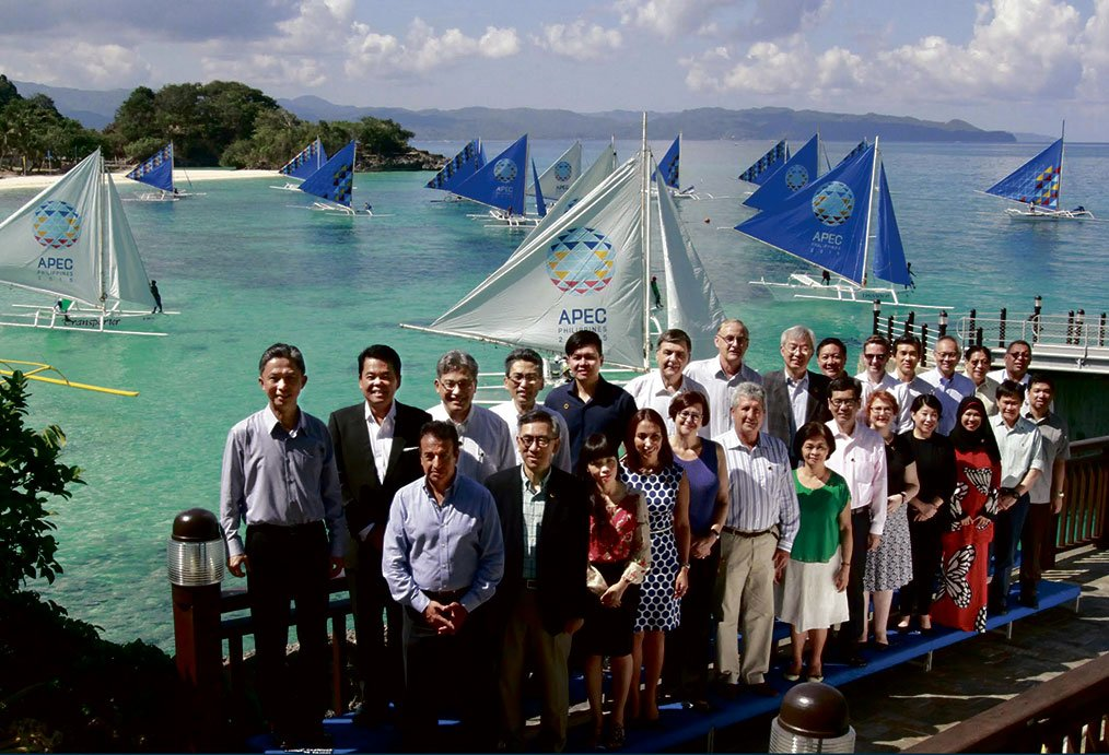 Delegates of the Second Senior Officials' Meeting pose for their official family photo at the Jetty Port of Banyugan Beach in Shangri-La's Boracay Resort and Spa.